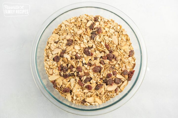 Oats, almonds, craisins, and spices in a bowl