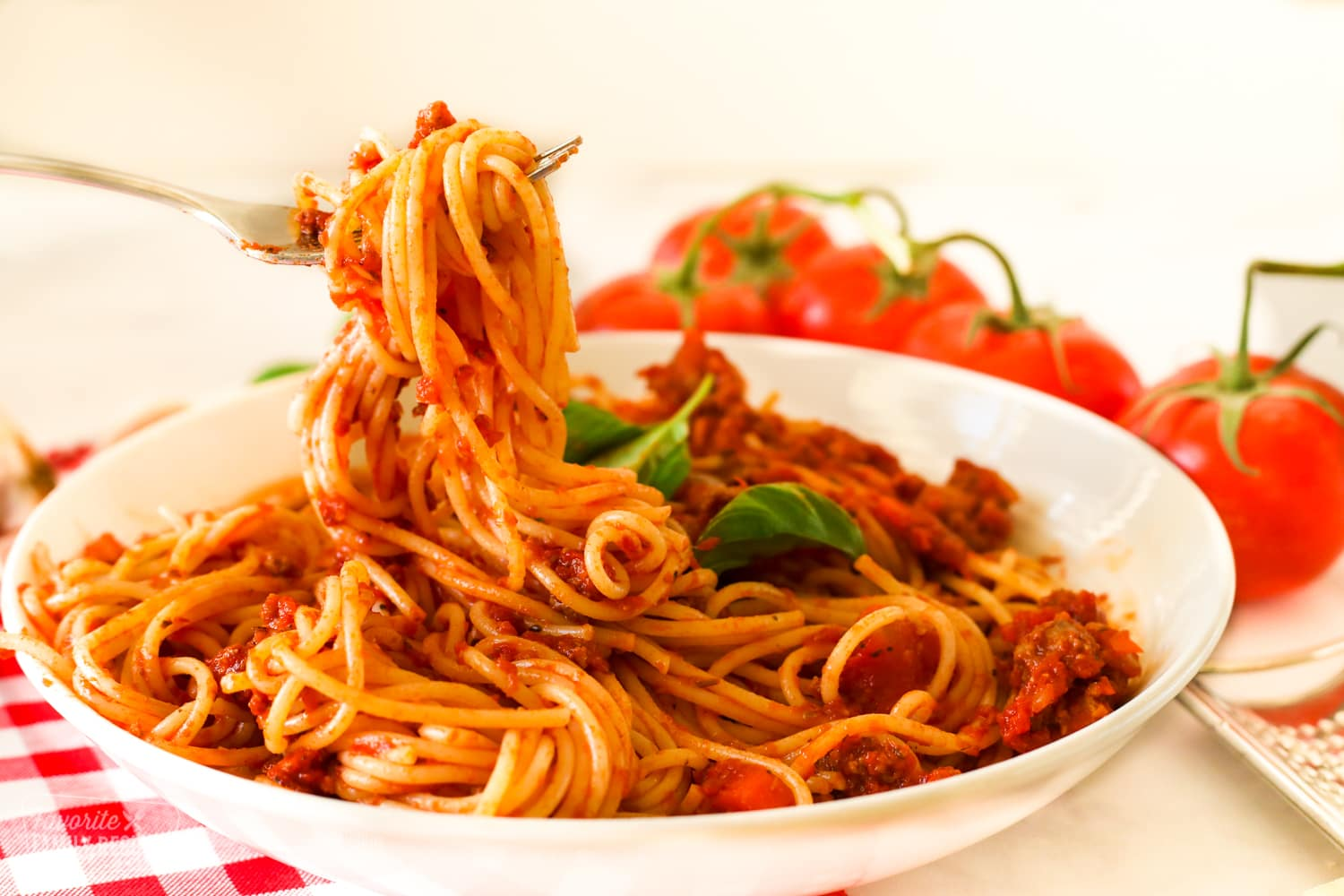 Spaghetti being twirled with a fork