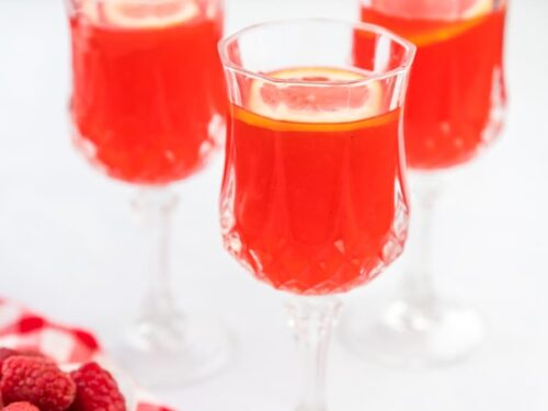 Three glasses of raspberry cordial