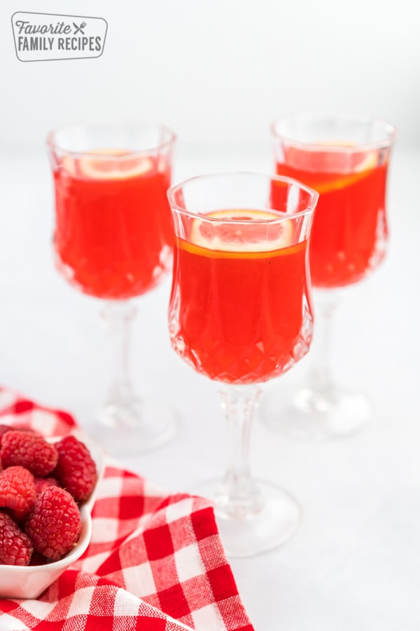Three glasses of raspberry cordial