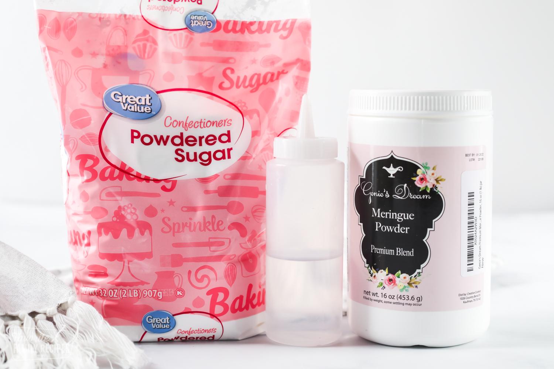 Powdered sugar, a water bottle, and meringue powder