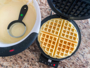 Waffle being cooked in a waffle iron