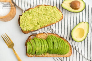 Two slices of toast, one with mashed avocado and one with sliced avocado