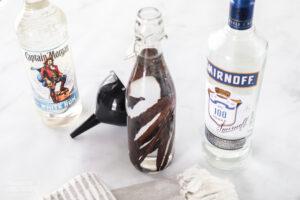 Bottle of vanilla, a bottle of vodka, and a bottle of rum