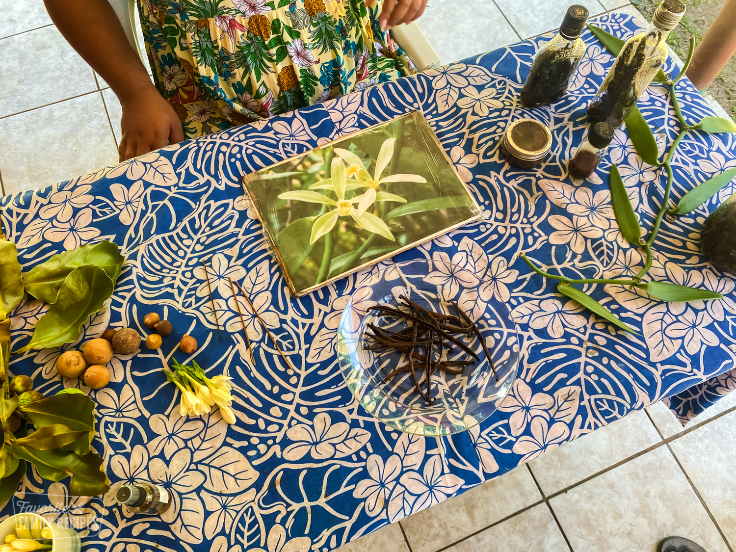 A table in Tahiti with Tahitian vanilla beans and other ingredients to make vanilla extract