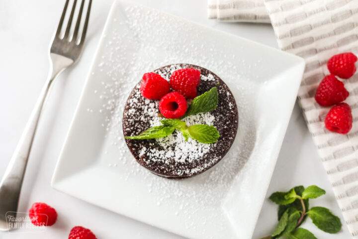 Small chocolate lava cake made in the instant pot on a plate with a fork