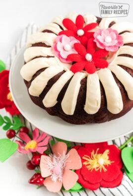 A red velvet bundt cake on a cake stand