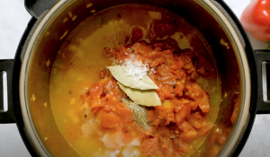 Chicken, tomatoes, may leaves, salt and pepper in an Instant Pot to make Gumbo