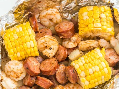 A Cajun Shrimp Foil Packet opened on a plate