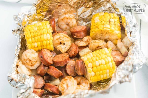 An open Cajun Shrimp Foil Packet on a plate