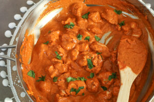 Cooked Chicken Tikka Masala in a large skillet sprinkled with cilantro