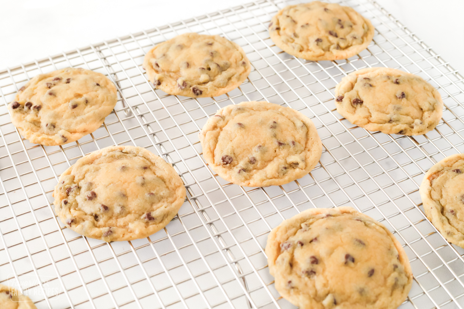 Bakery chocolate chip cookies on a cooling rack