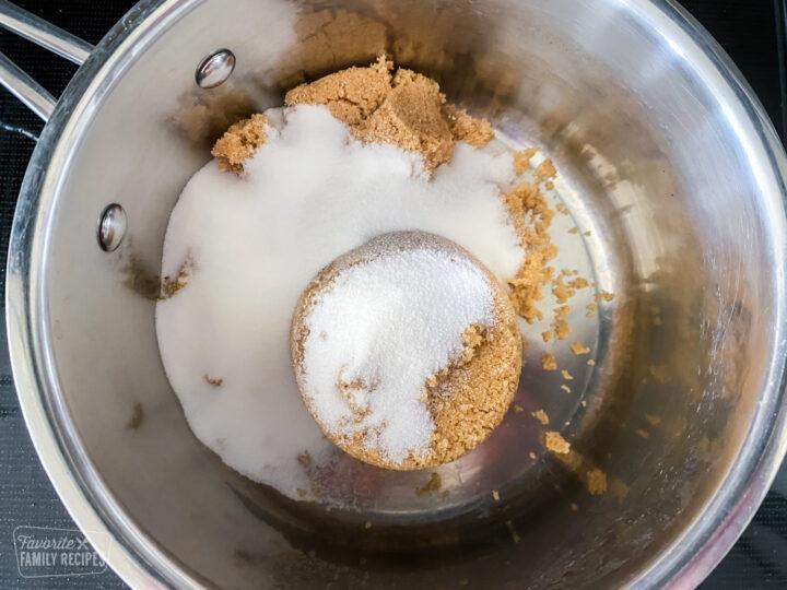 Brown sugar and sugar in a saucepan to make syrup