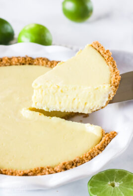 A slice of pie being lifted out of a pie pan with a pie knife