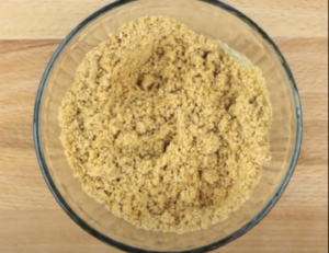 Crushed graham cracker crumbs in a bowl to make crust for Key Lime Pie