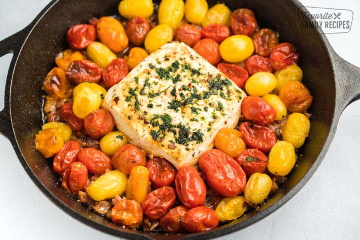 Heirloom cherry tomatoes and a block of feta baked in a cast iron skillet