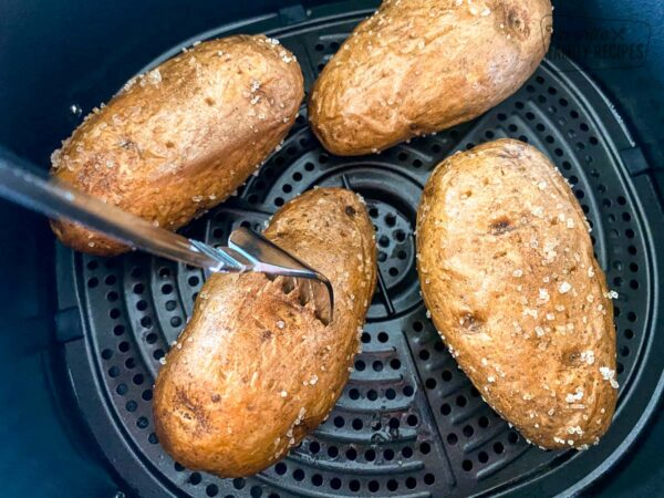 Baked potatoes that are fully cooked and ready