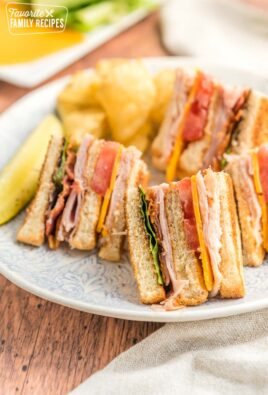 Quarters of a club sandwich served on a lunch plate