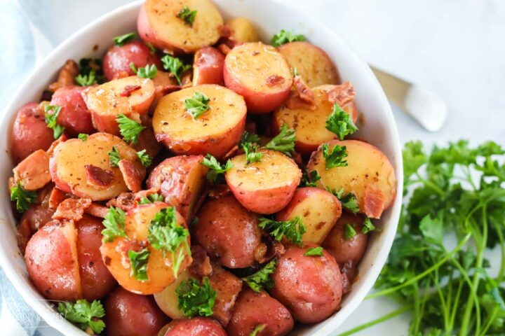 A close up of German potato salad made with mini red potatoes and a bacon vinaigrette.