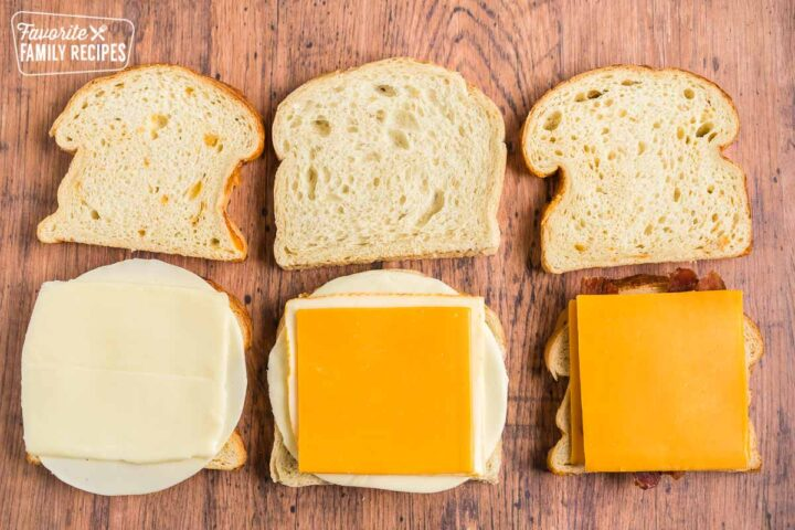Six slices of bread, three with cheese on them and three plain
