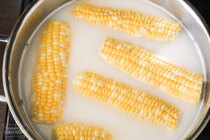 Pieces of corn in a pot ready to be cooked