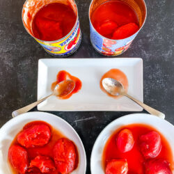 A comparison of two kinds of canned tomatoes, one from Italy and one from the US
