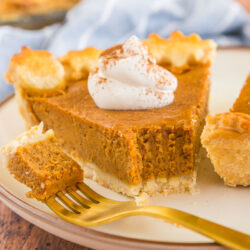 a slice of pumpkin pie with a bite taken out of it