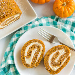 Two slices of pumpkin roll on a plate